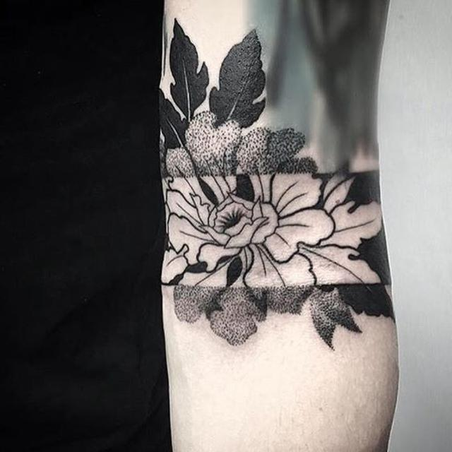 geometric blackwork floral mid arm tattoo