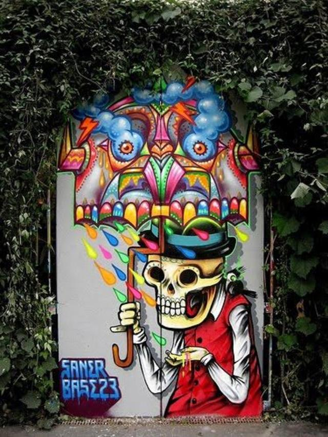 Street art. Saner. Colorful skeleton with umbrella