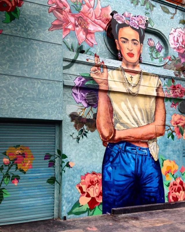 Street art interpretation of a modern Frida Kahlo in Buenos Aires